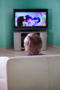 Little boy watching cartoon in television
