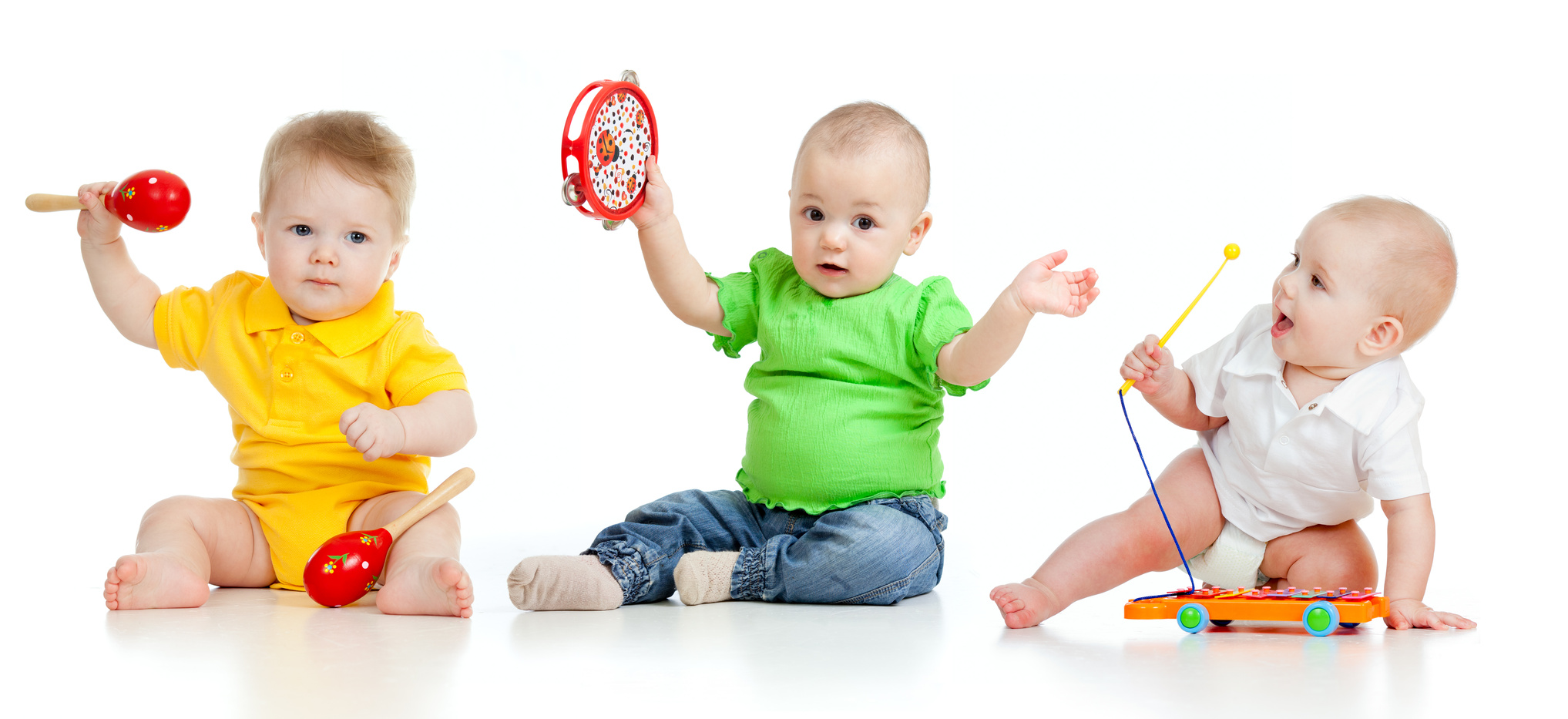 Children playing with musical toys isolated on white background