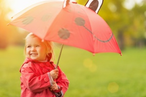 Happy baby with red umbrella