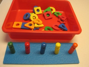 A colors and shapes sorting and stacking set